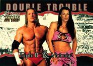 2003 Divine Divas (Fleer) Triple H and Victoria (No.79)