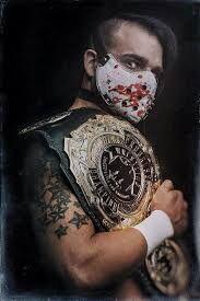 Jimmy havoc progress champion.jpg