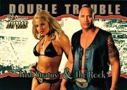 2003 Divine Divas (Fleer) Trish Stratus and The Rock (No.80)