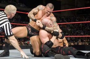 Randy orton performing a chinlock on kane.jpg