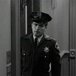 Policeman in hallway opening door