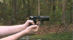 Pat Shooting A Gun.jpg