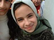 Iraqi girl smiles