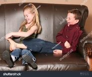 Stock-photo-cute-little-girl-tickling-brother-s-feet-84718252