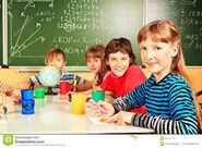 Education-group-school-children-studying-classroom-35707770