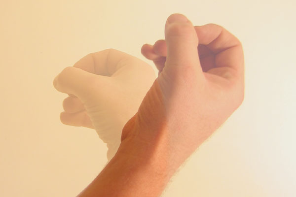 Fingers and thumb in circle downward motion.jpg