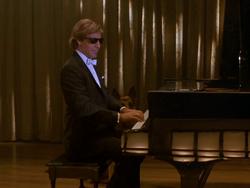 Sam at the piano