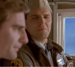 Sam leaps into a co-pilot of an air taxi that is transporting two young newlyweds, as he has to help the pilot Navy Capt. Cooper (right), who has had harrowing experiences trying to fly across the Bermuda Triangle in the past, fly across it again safely.