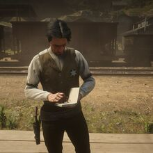 Sheriff Jones writting in a notebook.jpg