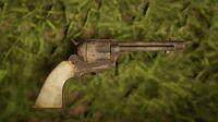 John's Cattleman Revolver on the ground