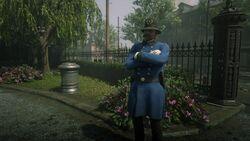 Saint Denis Policeman on guard duty.jpg