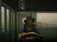 Lemuel Fike driving the boat