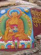 Buddha painted on a rock wall in Tibet