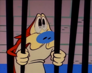 Stimpy really sad in the jail cell