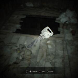 Resident Evil 7 Teaser Beginning Hour Back door key examine.jpg
