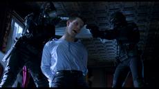 Resident Evil film - Matt gets detained by Sanitation Team.png