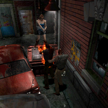 Resident Evil 3 Nemesis screenshot - Uptown - Street along apartment building - Jill Valentine gameplay 02.png