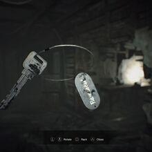 Resident Evil 7 Teaser Beginning Hour Basement Key examine.jpg