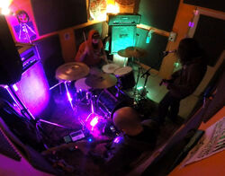 Green Yeti jamming in their cave.