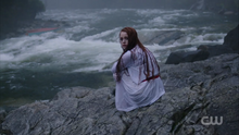 Season 1 Episode 1 The River's Edge Cheryl on the edge of the river.png