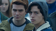 Season 1 Episode 7 In a Lonely Place Archie and Jughead in the crowd