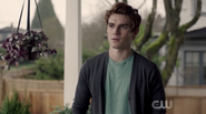 Season 1 Episode 1 The River's Edge Archie standing on porch
