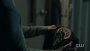 Season 1 Episode 13 The Sweet Hereafter Jughead holding Southside Serpent jacket 1