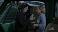 Season 1 Episode 11 To Riverdale and Back Again Betty and Jughead under umbrella