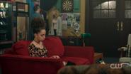 Season 1 Episode 9 La Grande Illusion Valerie sitting on a couch