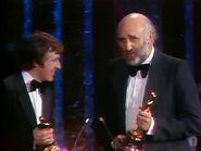 John Barry receiving Oscar