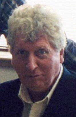 Том Бейкер