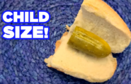Child sized sandwiches with pretty big pickles in them