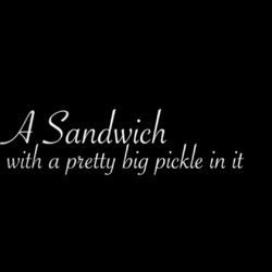 A Sandwich With A Pretty Big Pickle In It