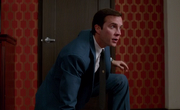 Supernatural-s8-ep12-Henry-Winchester-crouching-in-front-of-closet-he-just-time-traveled-through.png