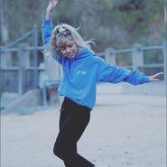 Jennette wearing merch