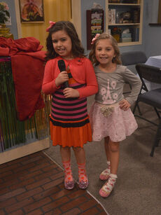 Ruby and Gwen holding a microphone.jpg