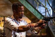 Ezekiel Banks points a gun at William Schenk