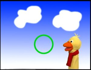 Quacker the Duck with the Green Circle on a Blue Sky Background.jpg