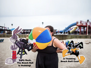Bugs bunny films the woman blowing in the beach ball