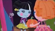 Bea gives Scraps a pumpkin