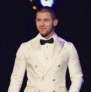 Nick Jonas in a white tux