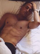 Colton-haynes-shirtless-in-bed-2015hollygossip