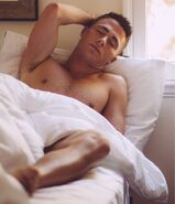 Colton-haynes-shirtless-in-bed-barefoot-2015hollygossip