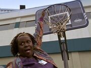 2x17 Laverne hangs from hoop.jpg