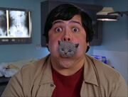 5x15-Guy with Kitten in his Mouth.jpg