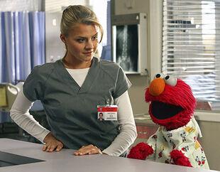 8x5 Denise looks at Elmo