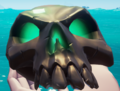 Disgraced bounty skull in hand.png