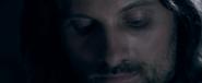 Aragorn qui baisse les yeux