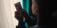 305 Eric holds a photo of him and Adam