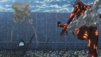 The Colossal Titan kicks Eren